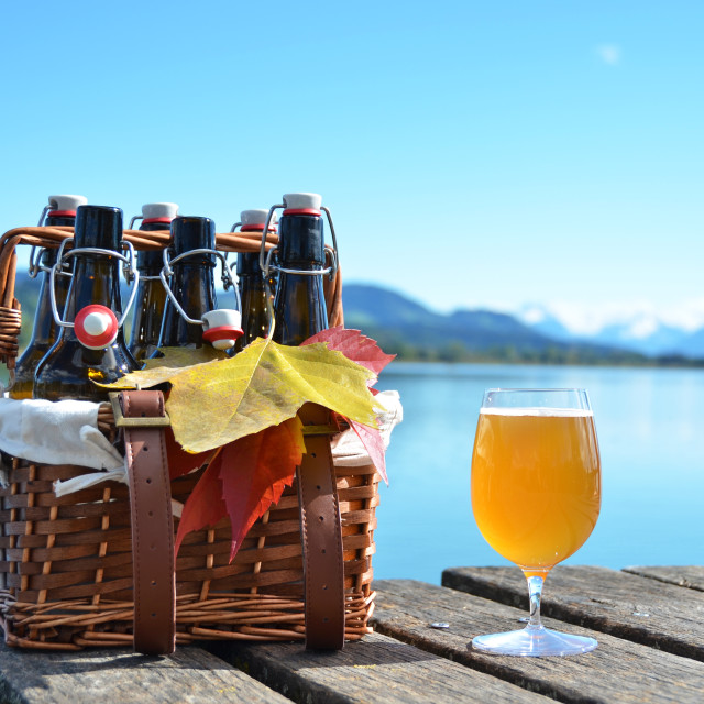 """Beer bottles in the vintage basket on a wooden pier"" stock image"