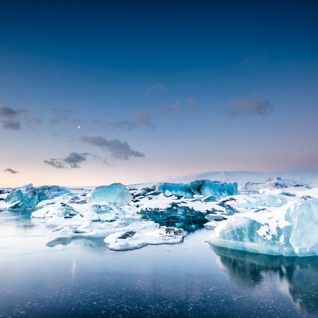 """Icebergs floating in Jokulsarlon glacier lake at sunset. South Iceland."" stock image"