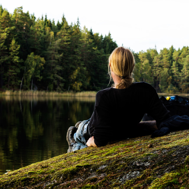 """""""Hiker resting by lake"""" stock image"""