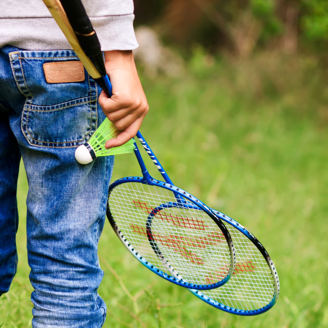 """Child with badminton rackets"" stock image"