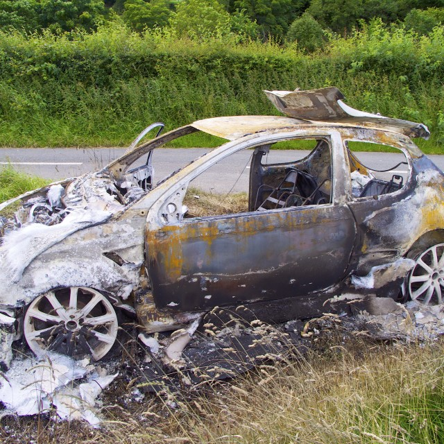 """Burnt out car"" stock image"