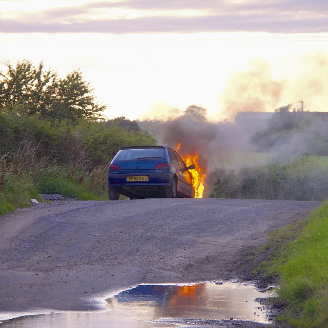 """Car on fire."" stock image"
