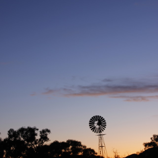 """Aussie sunrise with tiny moon"" stock image"