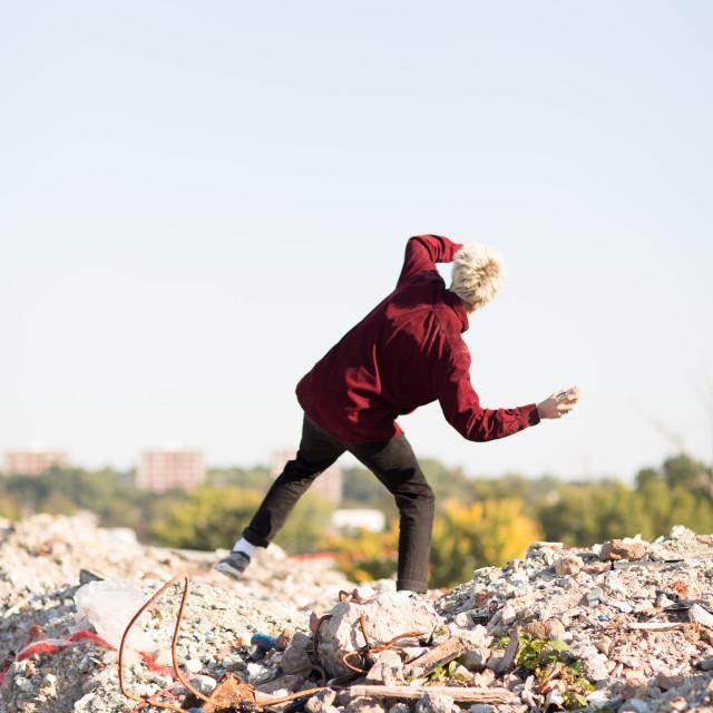 """""""boy throwing rocks"""" stock image"""