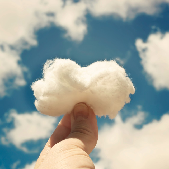 """Cotton cloud in hand"" stock image"