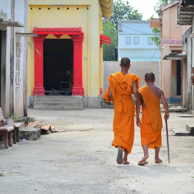 """Buddhist monks at an ancient Khmer temple"" stock image"
