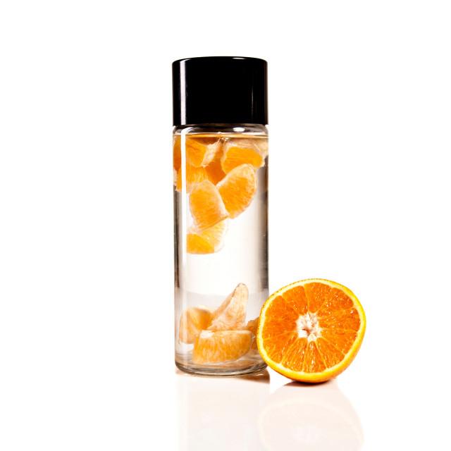 """""""Bottle with orange"""" stock image"""