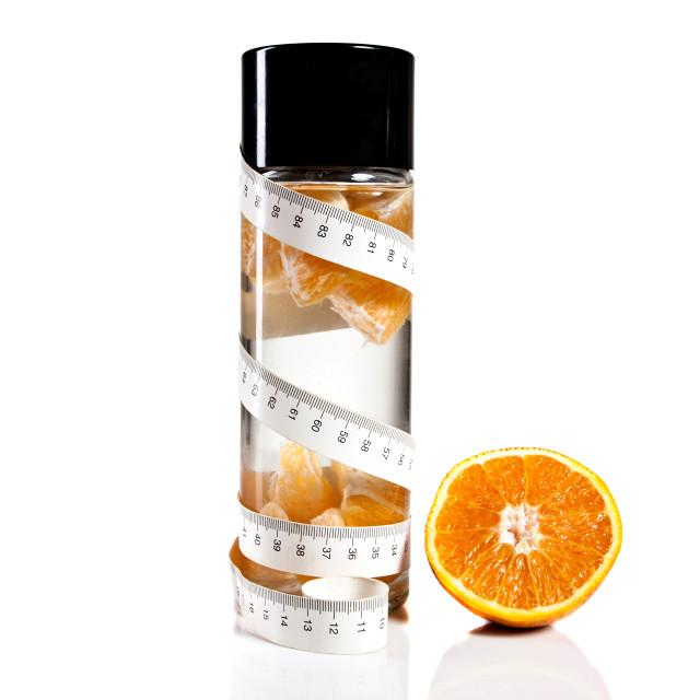 """Bottle, orange and measure tape"" stock image"