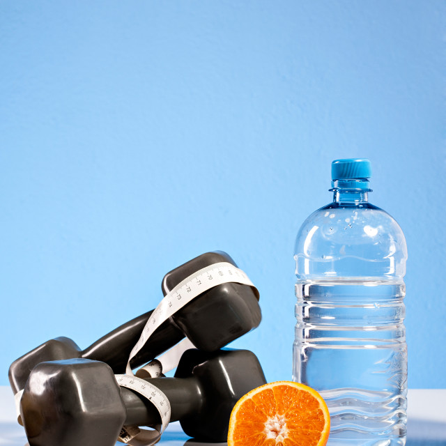 """Oranges, weights and botte of water"" stock image"