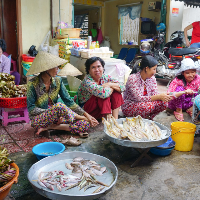 """Asian women selling fresh fishes"" stock image"