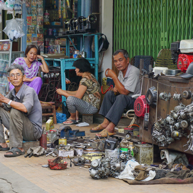 """People selling tools at the outdoor market"" stock image"