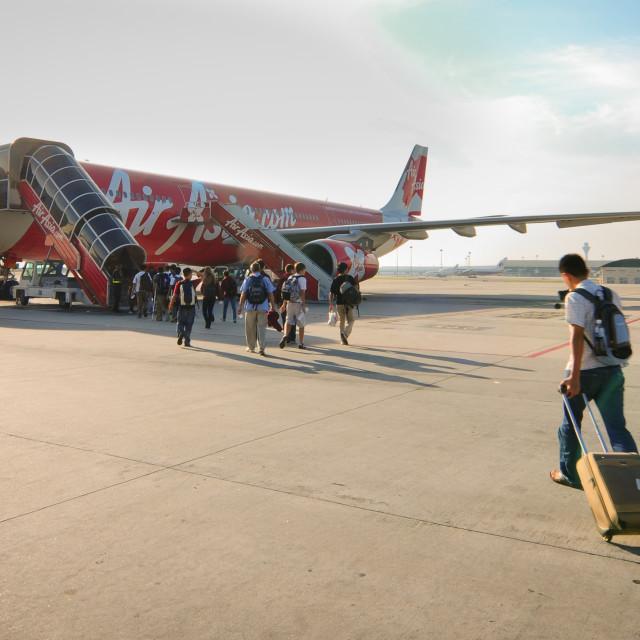 """Passengers boarding to AirAsia airplane at KLIA2"" stock image"