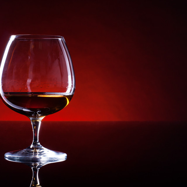 """Cognac in a glass on a black table"" stock image"