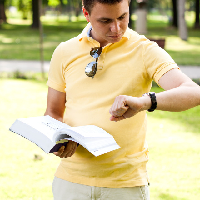 """Young caucasian man holding a book"" stock image"
