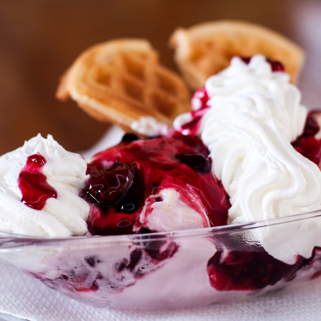 """Ice cream with cherries and busicuit"" stock image"