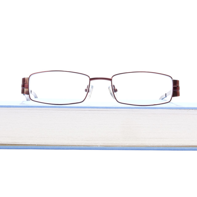 """Eyeglasses on the blue book"" stock image"