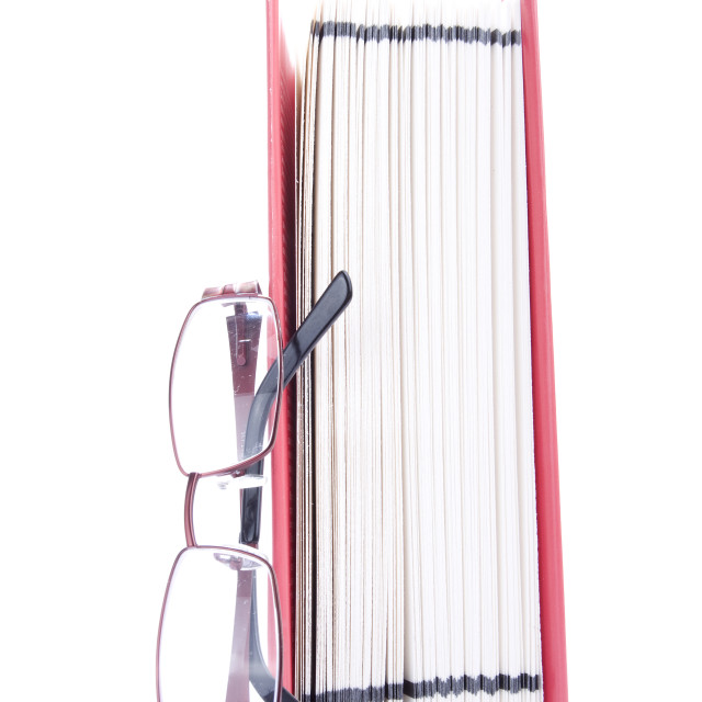 """Red open book and eyeglasses"" stock image"