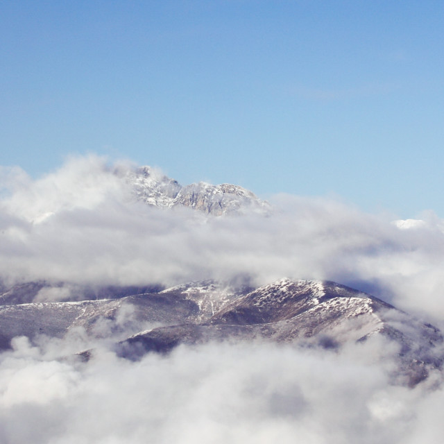 """""""Clouds are flying over the snow mountain"""" stock image"""