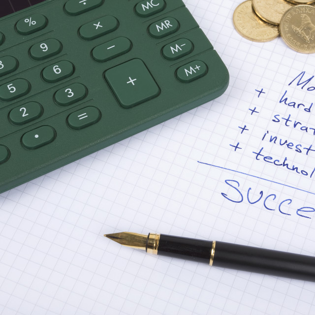 """Ink pen on the paper with some business quotes, calculator and c"" stock image"