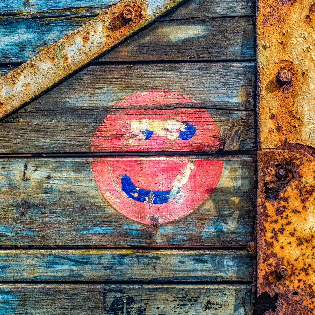 """Smiley face and peeling paint"" stock image"