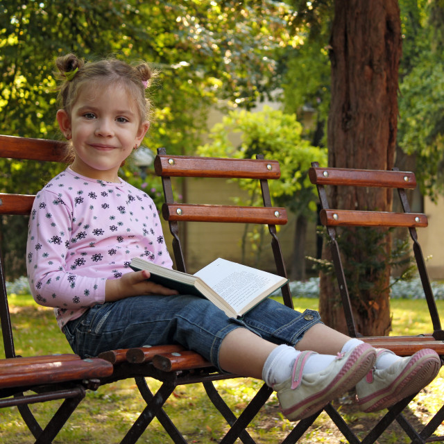 """""""little girl with book"""" stock image"""