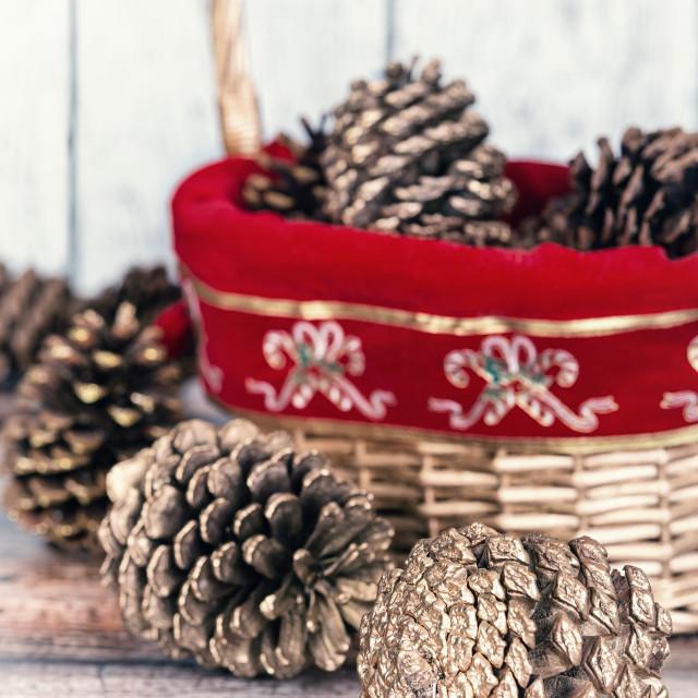 """Christmas basket of golden pine cones"" stock image"