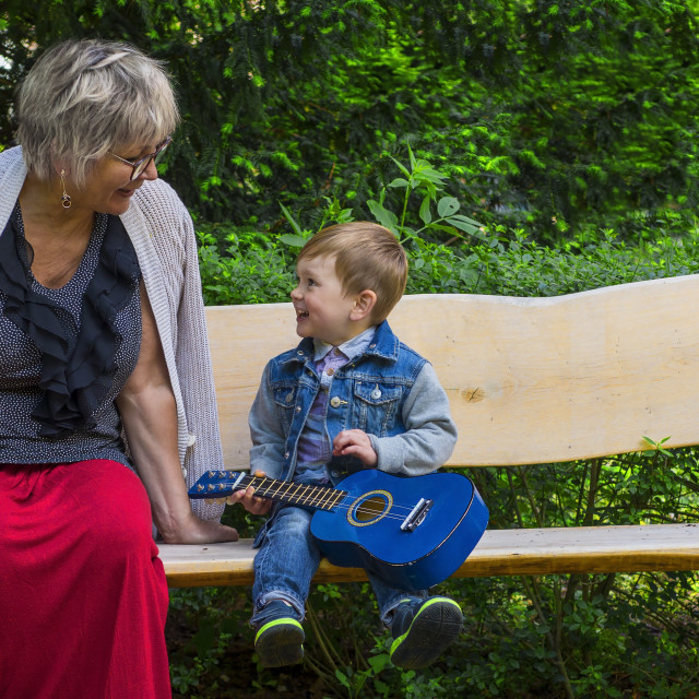 """Grandmother and grandson singing together"" stock image"