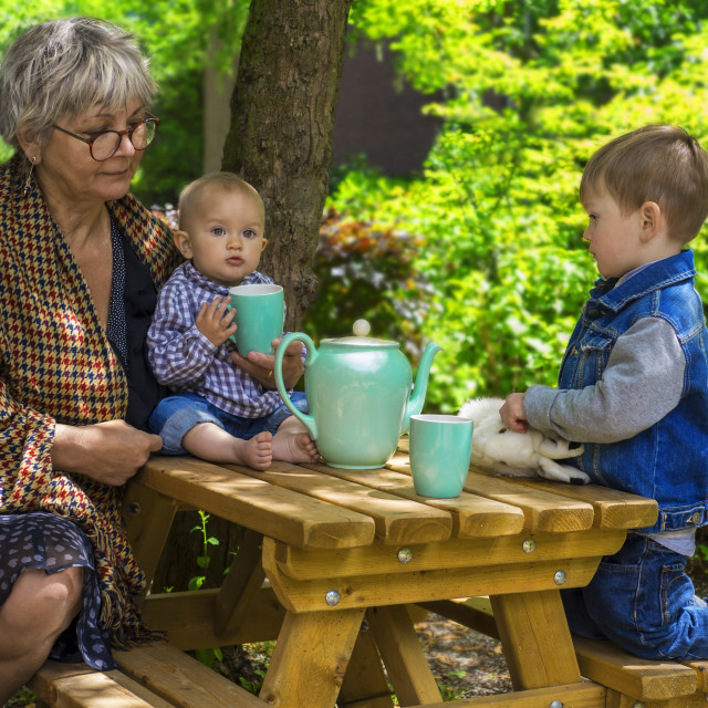 """Tea time with grandmother"" stock image"