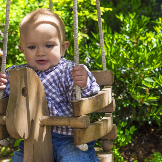 """Baby in a swing"" stock image"