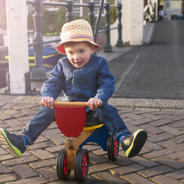 """cute toddler on a tricycle"" stock image"