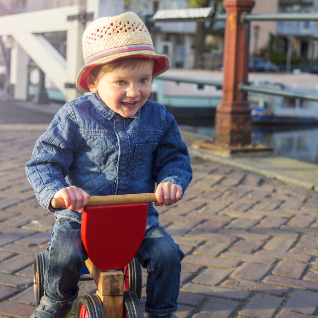 """Adorable toddler on a tricycle"" stock image"