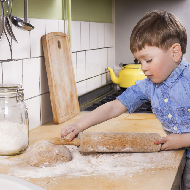 """Little boy baking in the kitchen."" stock image"