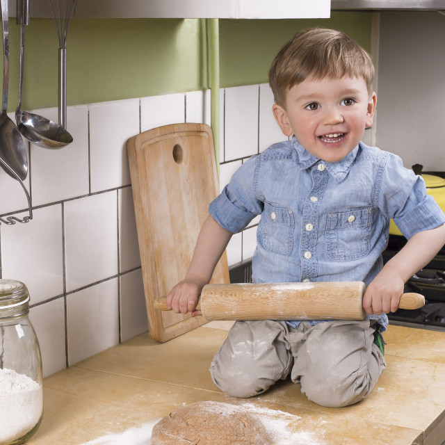 """Cute little boy making pizza"" stock image"