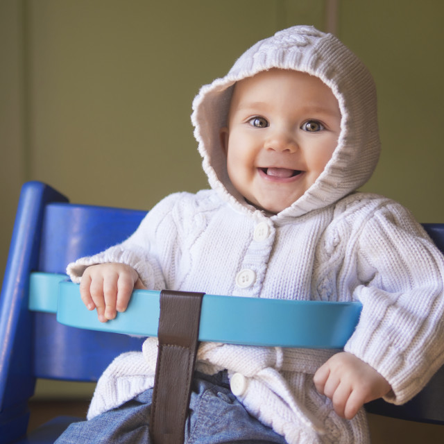 """Cute baby girl in a blue chair"" stock image"