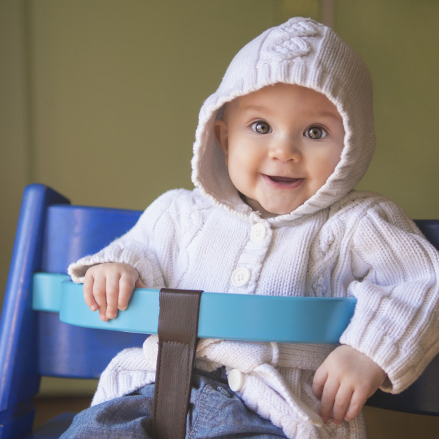 """Beautiful baby girl in a chair"" stock image"