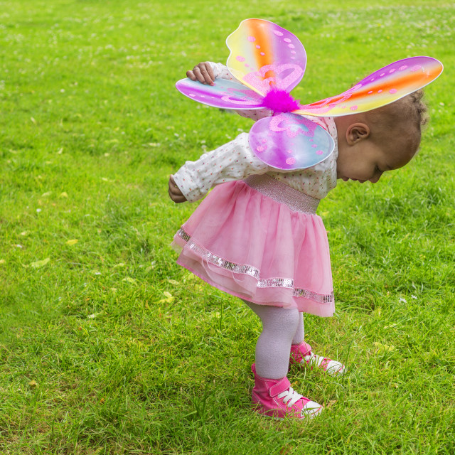 """Cute toddler with butterfly wings"" stock image"