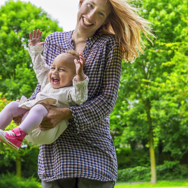 """Mother and daughter playing in the park"" stock image"