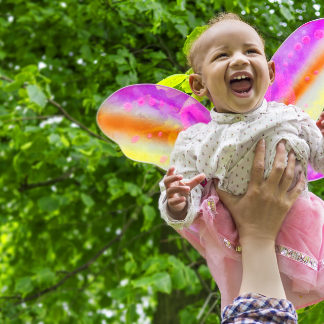 """Adorable baby girl with butterfly wings"" stock image"
