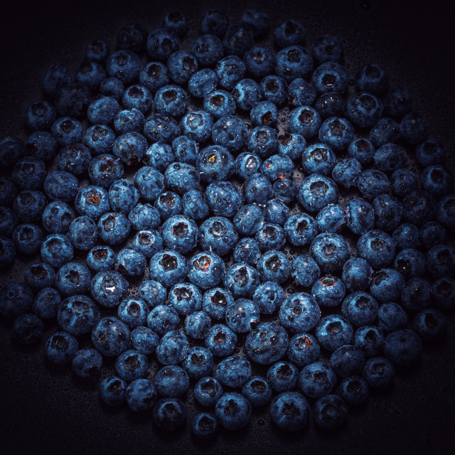 """Wet blueberries on black slate"" stock image"