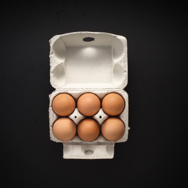 """Raw eggs in carton box isolated"" stock image"