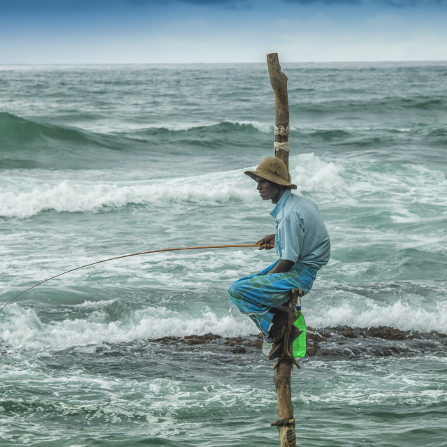 """""""Local fisherman on a pole"""" stock image"""