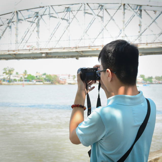 """Nature photographer with digital camera"" stock image"