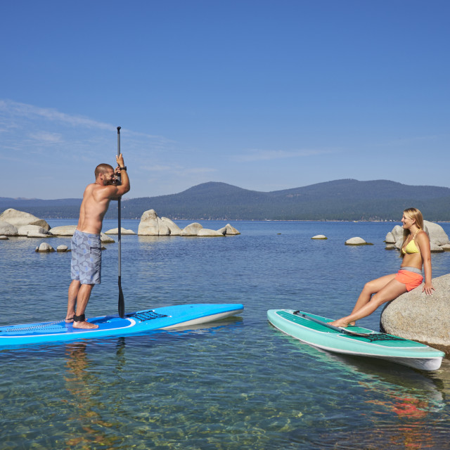 """""""Two Paddle Boarders on Lake Tahoe."""" stock image"""