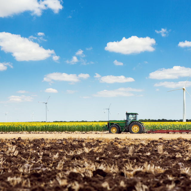 """""""Tractor plowing the fields"""" stock image"""