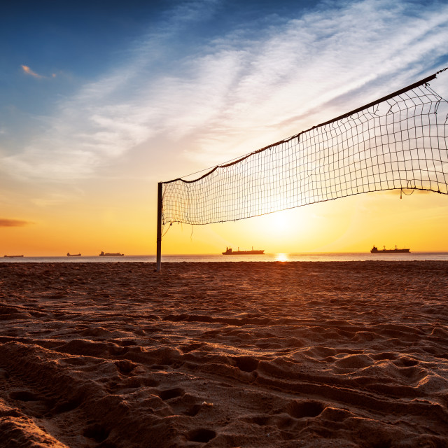 """Volleyball net and sunrise on the beach"" stock image"