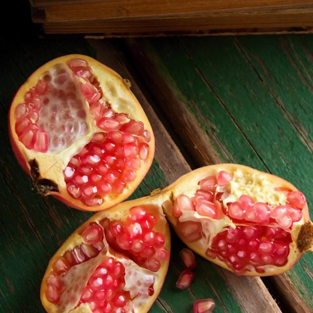 """Pomegranate divided to three parts"" stock image"