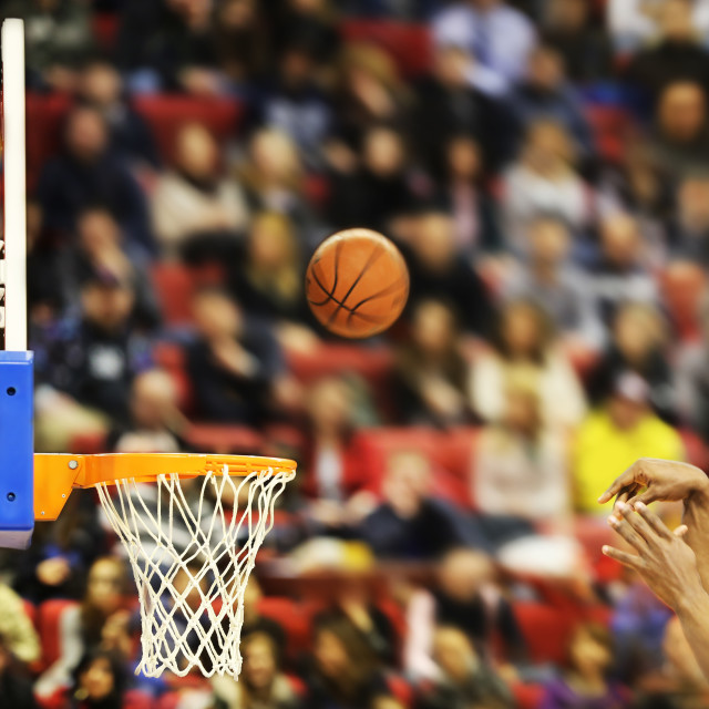 """Scoring the winning points at a basketball game"" stock image"