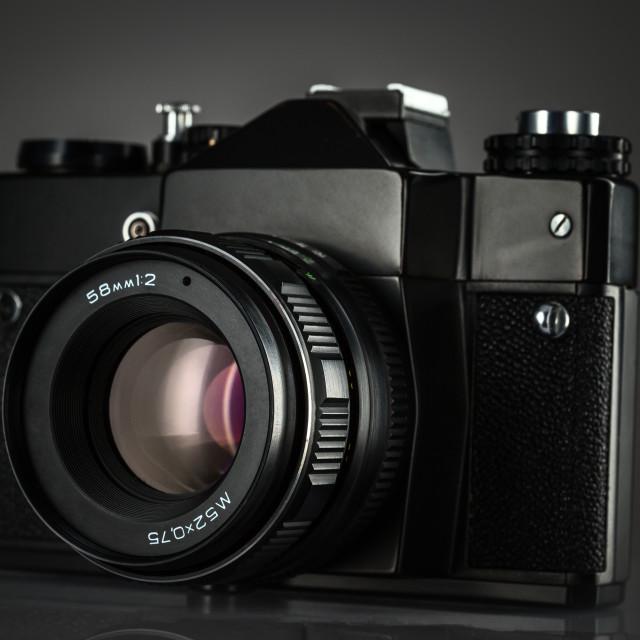 """Vintage camera on black background"" stock image"