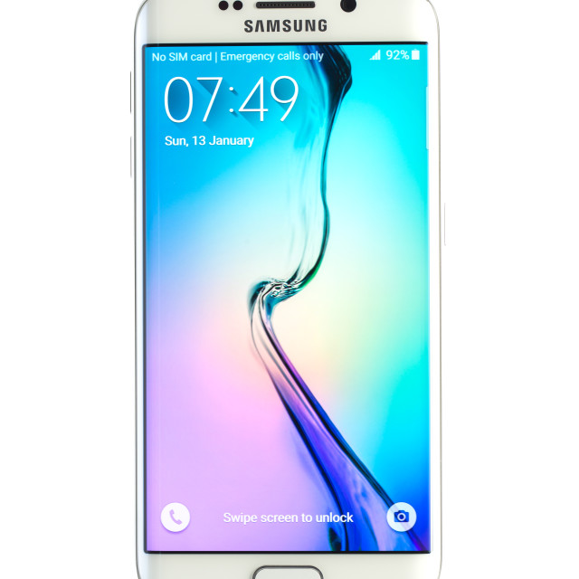 """""""Varna, Bulgaria - April 13, 2015: Studio shot of a white Samsung Galaxy S6 Edge smartphone, with 16 mP Camera, quad-core 2,7 GHz and 440 x 2560 pixels Display Resolution"""" stock image"""