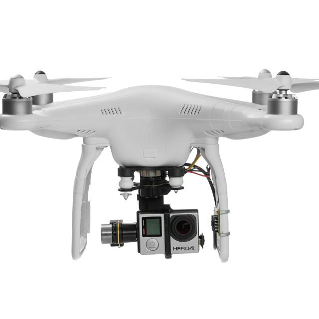 """Varna, Bulgaria - MAY 28 ,2015: Flying drone quadcopter Dji Phantom 2 with digital camera GoPro HERO4 isolated on white"" stock image"